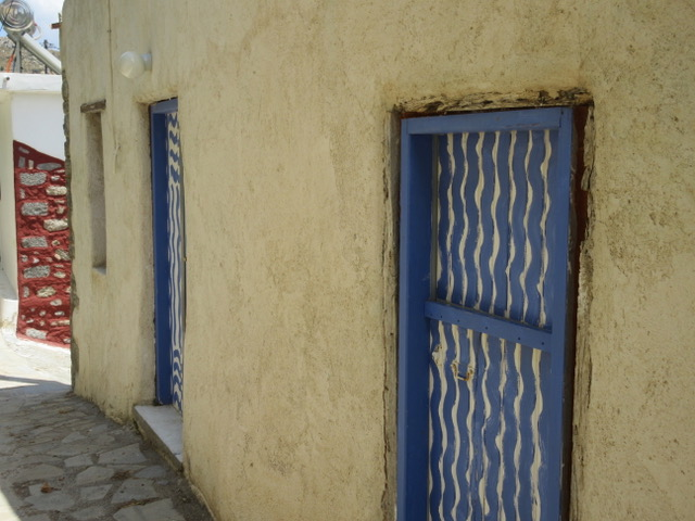 House with blue doors.